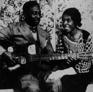 Leadbelly and Martha with the guitar he played on his LOC recordings